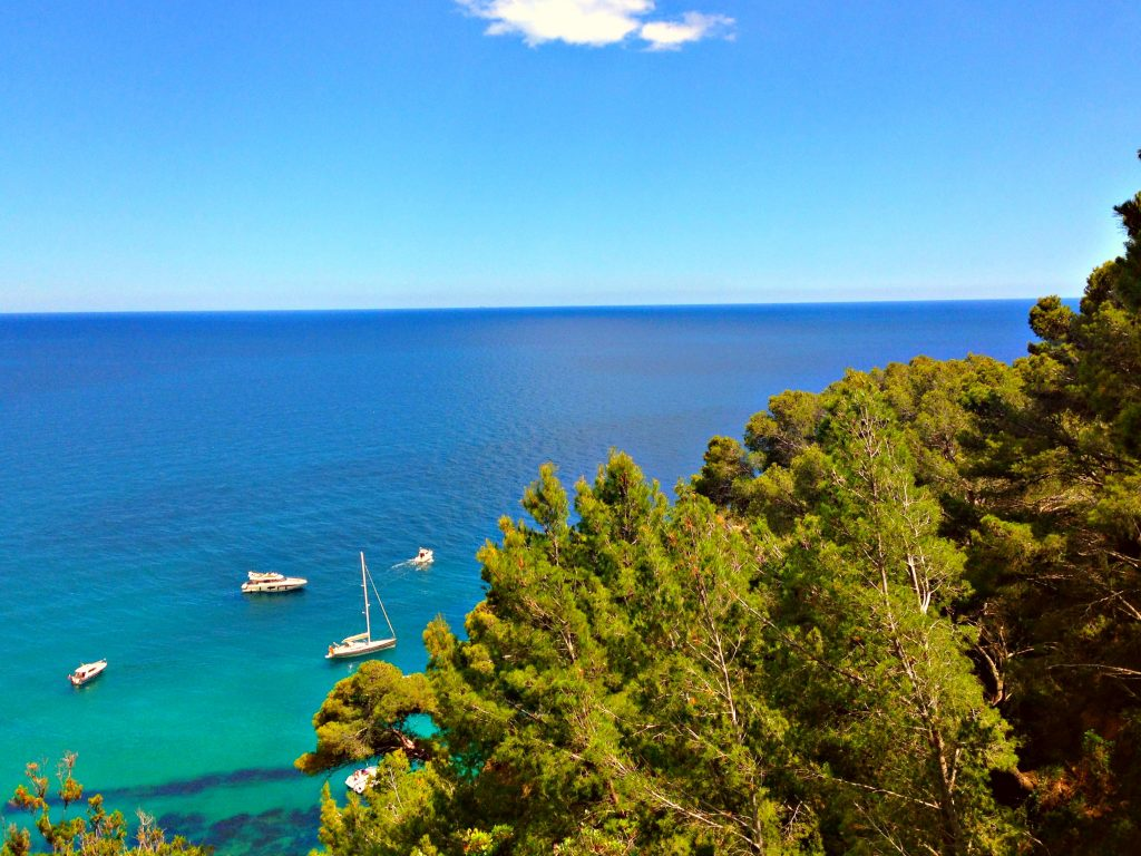 Cobalt blue Mediterranean Sea cycling along the Costa Brava coastal road