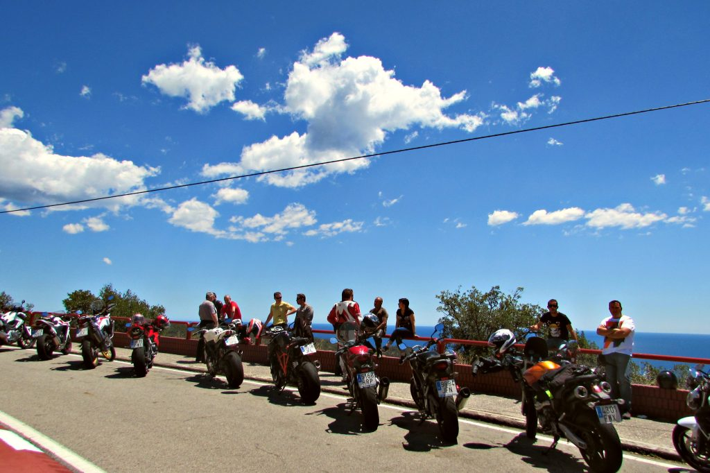 Motocycles lined up at a vista point along the Costa Brava coastal road just north of Tossa de Mar,