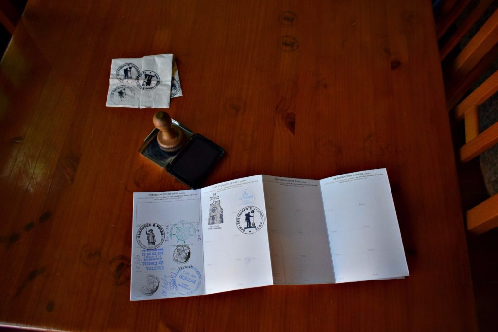 Stamping my passport on the Camino de Santiago