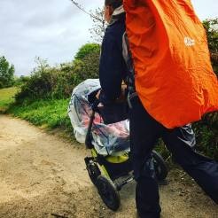 Woman hiking with baby in a pram the Camino de Santiago - Driftwood Journals Travel Blog