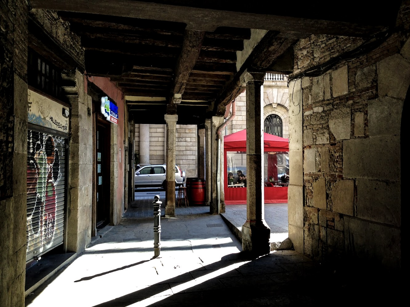 Sun and shadows in the backstreets of Raval, Barcelona