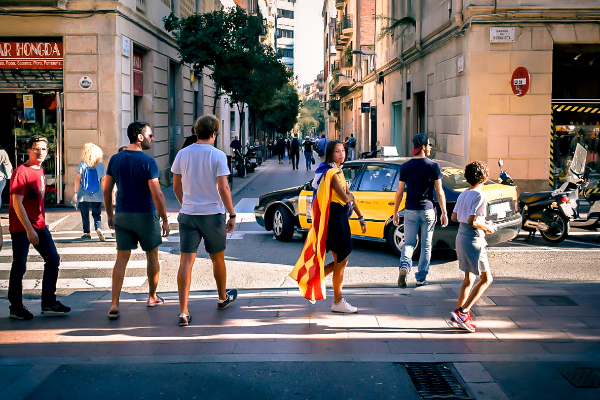 Girl wearing Catalan flag in Gracia, Barcelona - by Ben Holbrook