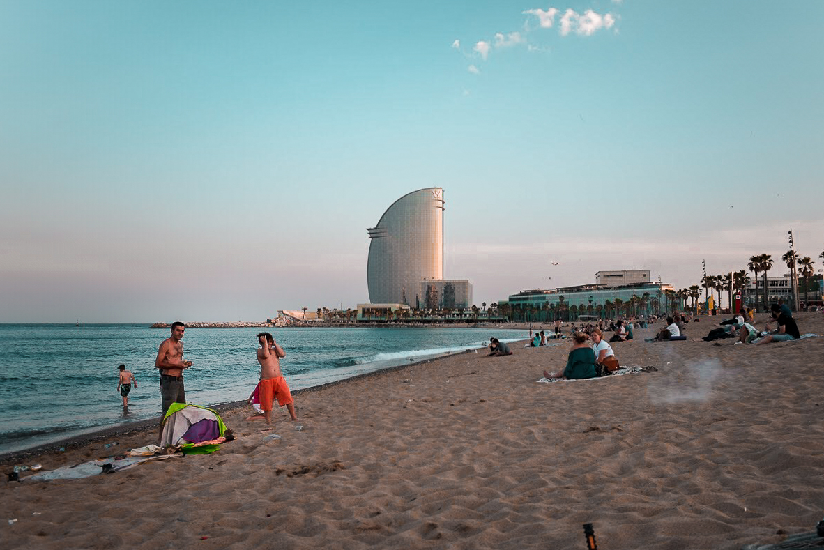 Barceloneta beach at sunset - by Ben Holbrook