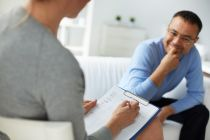 client in therapy looking at emotional intelligence techniques