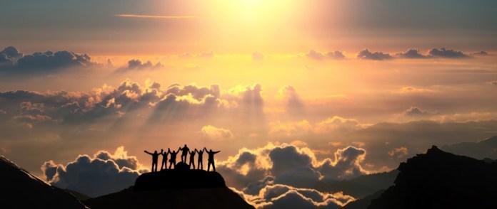 silhouettes on a mountain