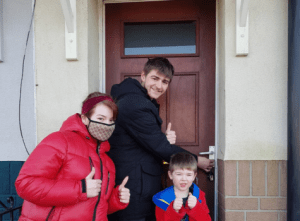 A family entering their new home