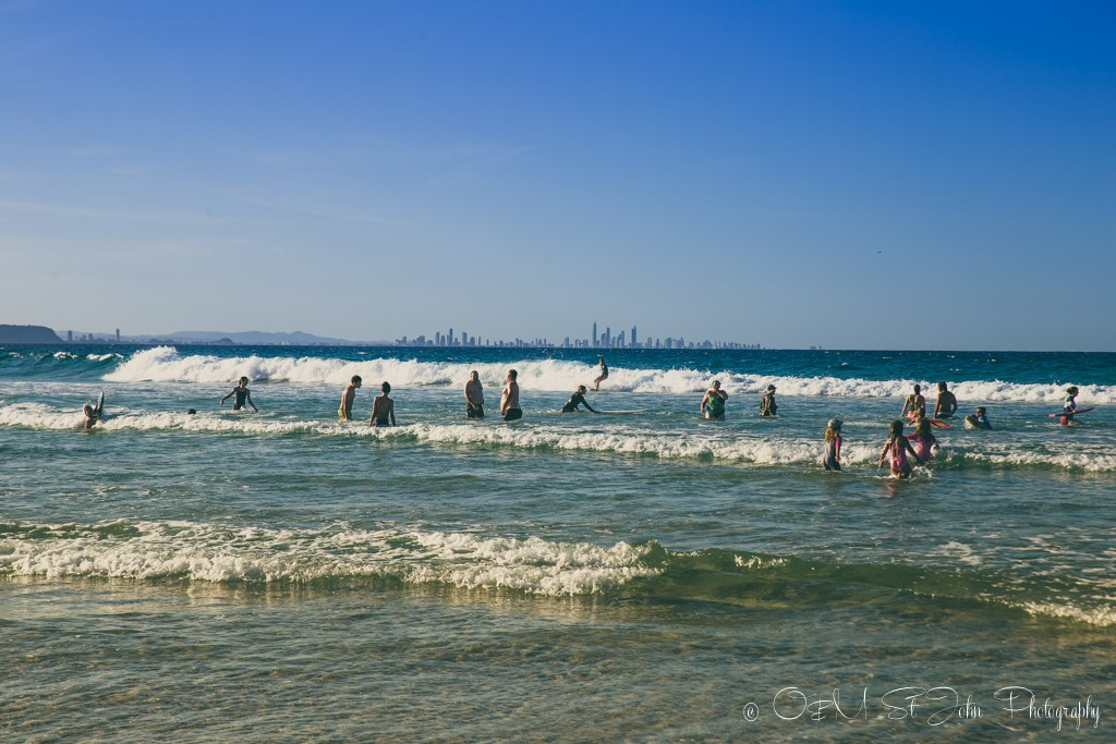 Families on the beach in Coolangatta, Gold Coast, QLD