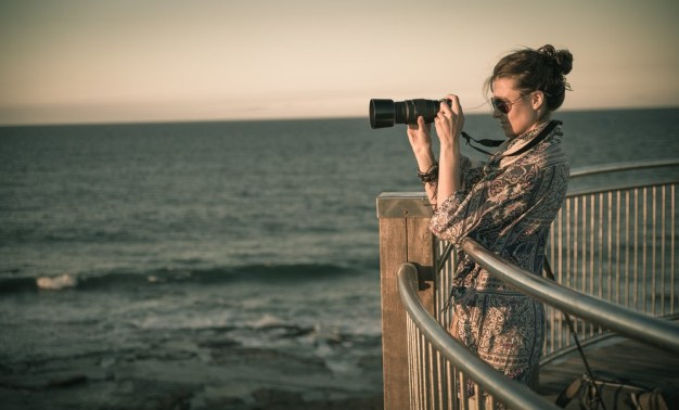 Oksana with camera in Newcastle. Australia
