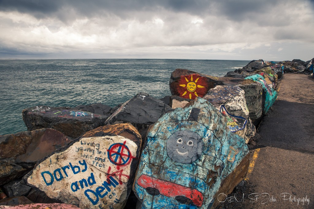 Rock paintings at breakwall, Port Macquarie, NSW