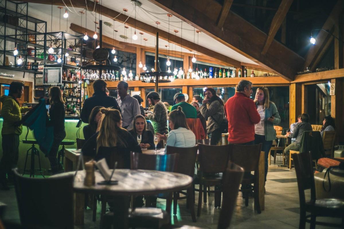 The crowd gathered at Bar Pionero at night