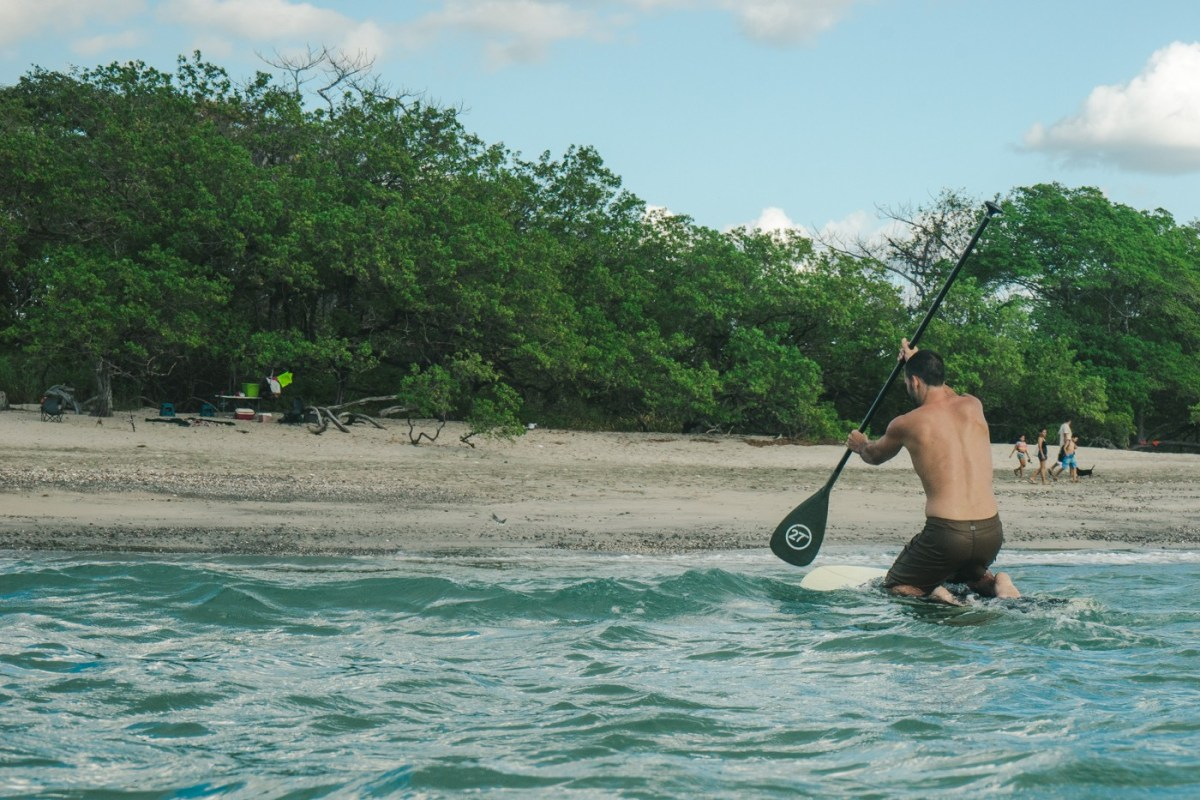 Max paddle boarding in Playa Lagartillo, Costa Rica