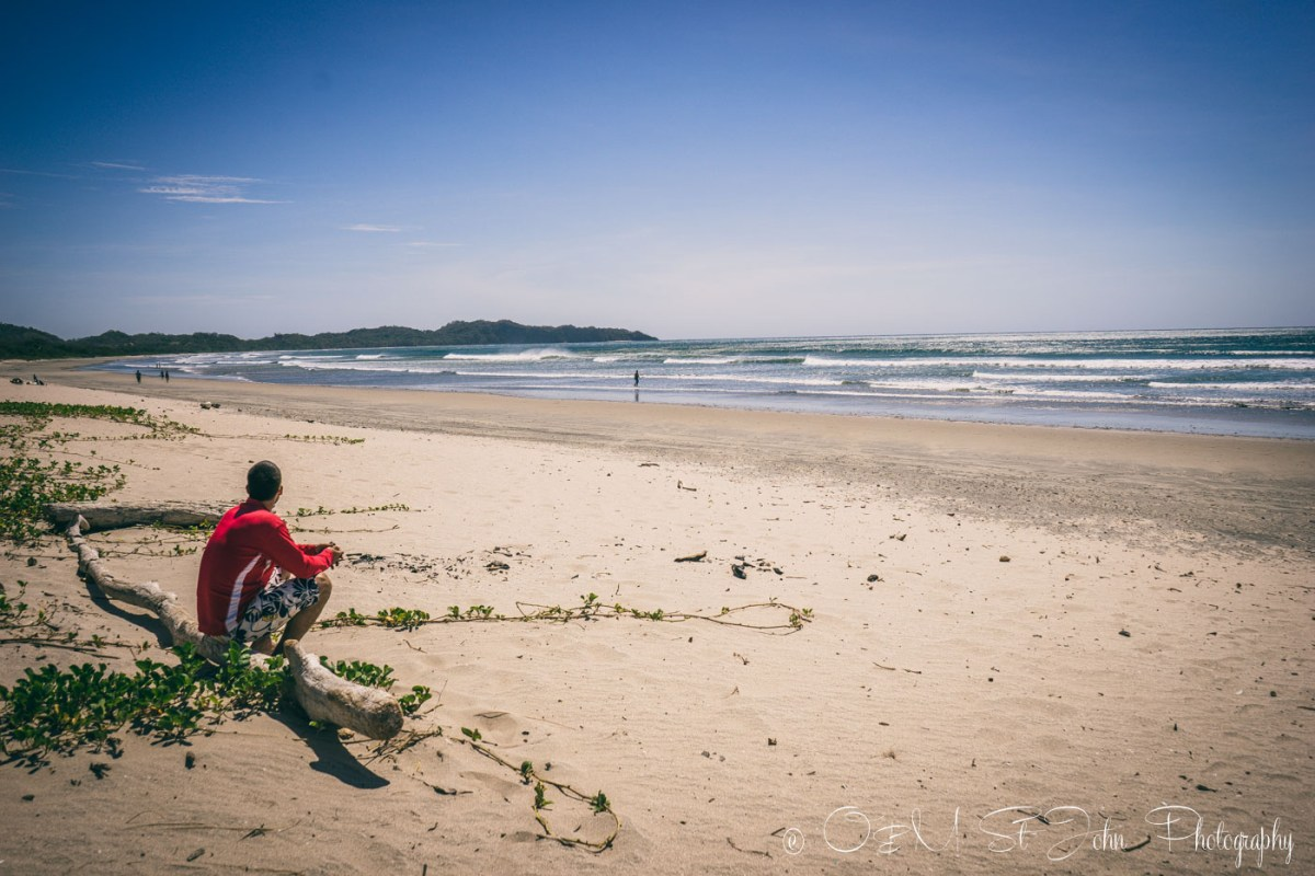 Max watching the surf on Playa Guiones. Nosara. Costa Rica