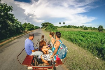 Hitching a ride with a local in Vinales, Cuba
