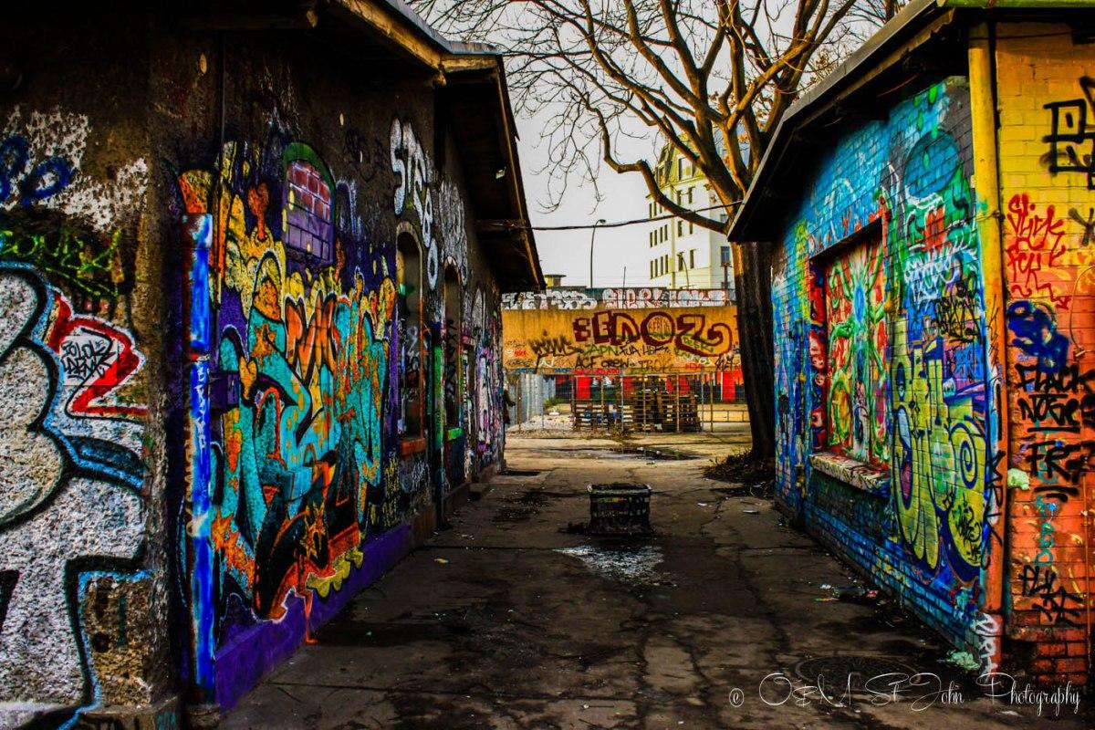 Exploring hidden alleyways on the alternative walking tour of Berlin. Germany