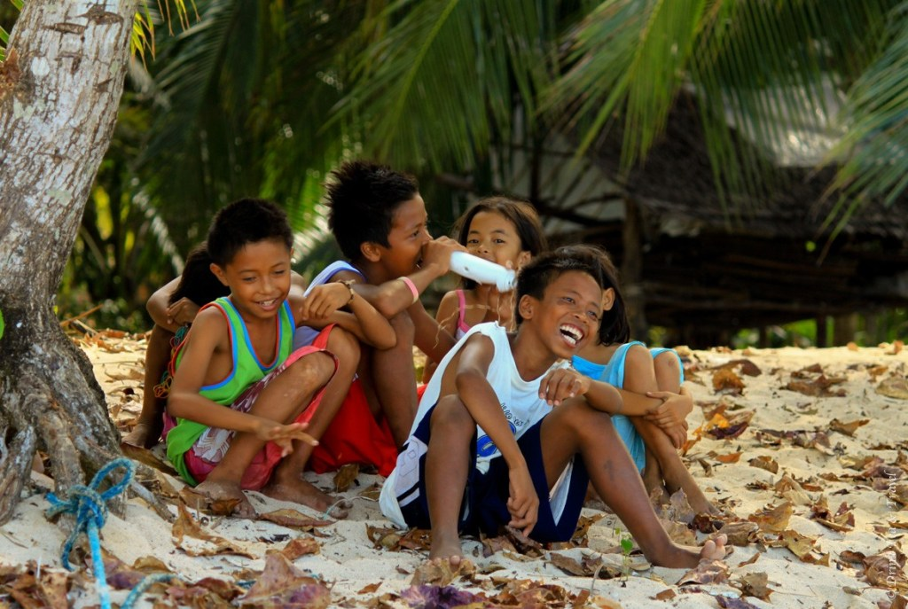 Kids enjoying life on a small island in Palawan, Philippines