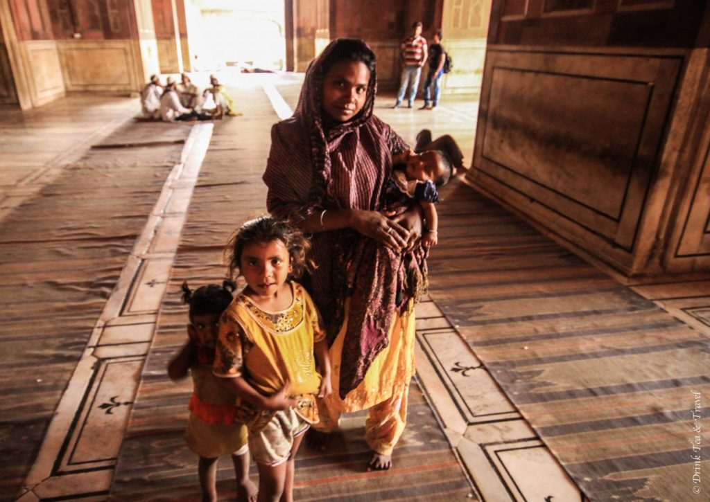 India Travel: Woman and children begging inside the Agra Fort, India