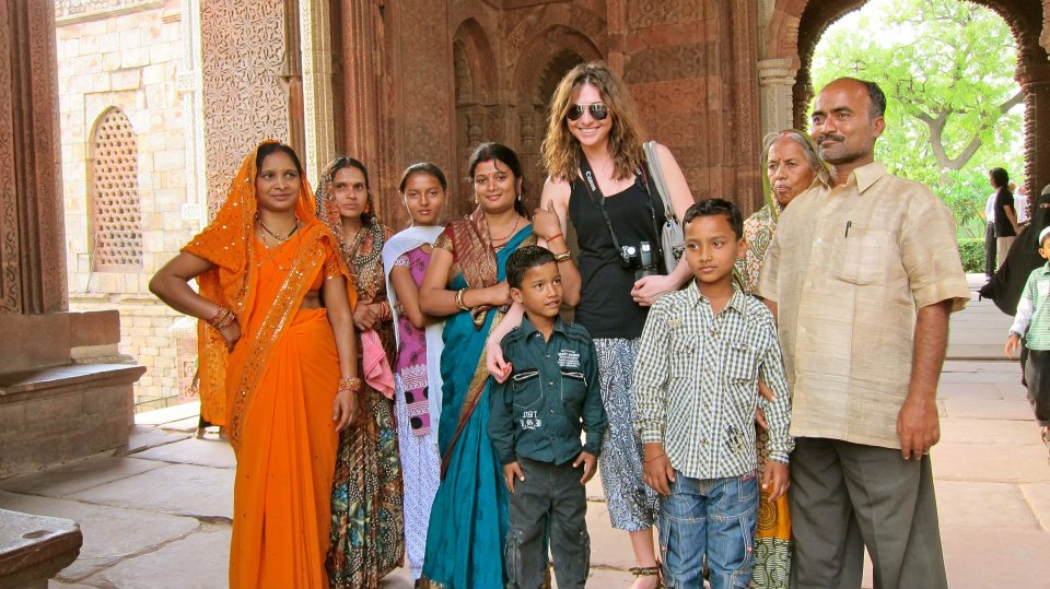 Posing for a photo with an Indian family