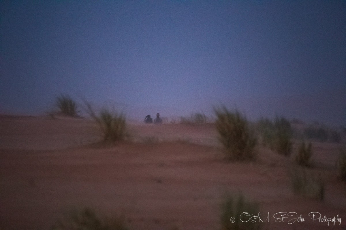 Max and Muhamed in the sandstorm, Erg Chebbi, Sahara Desert. Morocco