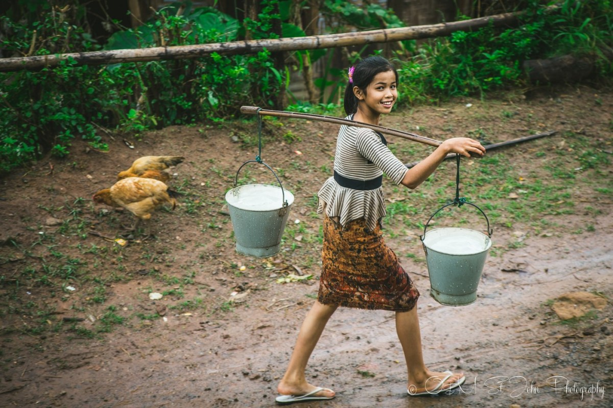 Young girl carries water to her home in Palaung Village. Hsipaw. Myanmar