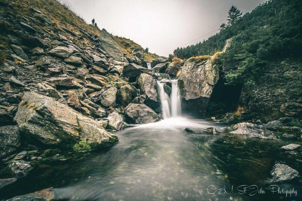 Small waterfall along the Transfagarasan Highway. Road trip in Romania