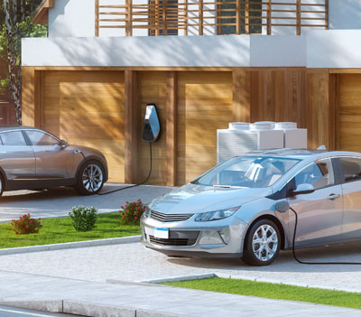 EV cars charging out front of Duplex