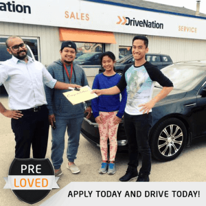 Happy Customer Buying A Used Car