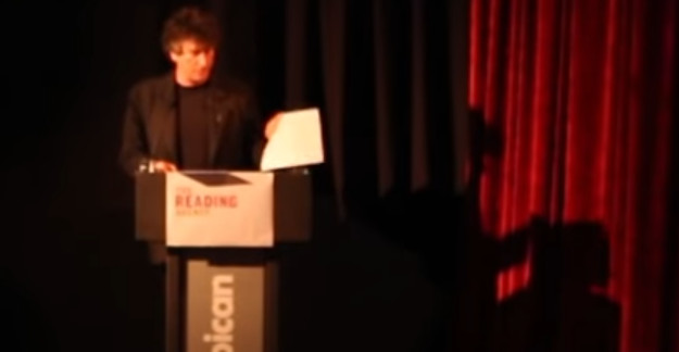 neil gaiman shadow on red curtain