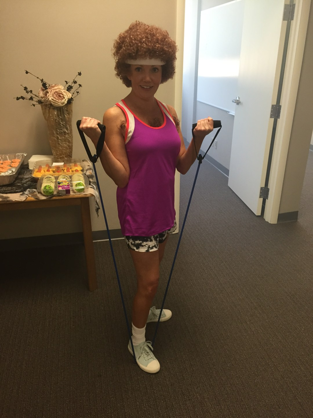 Veronica Taylor poses as Richard Simmons for the Driver's Alert 2015 Halloween Party