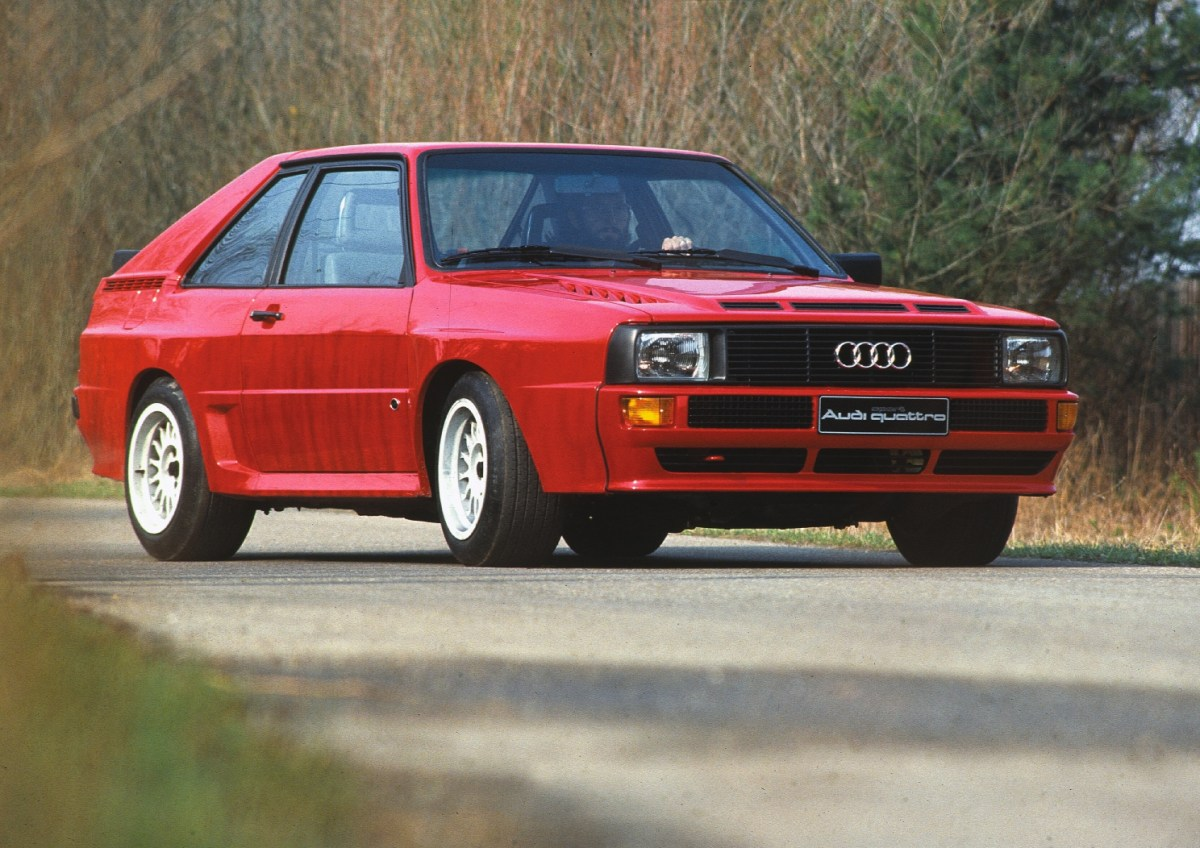 1983: five-cylinder gasoline engine with four-valve technology, turbocharger and intercooler: In September 1983, Audi presents the Audi Sport quattro (B2) at the International Motor Show in Frankfurt am Main. It is powered by a 2.1-liter highperformance engine with four-valve technology that produces 225 kW (306 hp) at 6,700 revolutions per minute. The maximum torque of 350 newton meters (258.15 lb-ft) is available at 3,700 rpm. Delivery commences in May 1984. The Audi Sport quattro (B2) is a special series limited to 214 vehicles, produced to meet homologation requirements for rallying. The rules stipulate that displacement must be limited to a maximum of 2,133 cc.