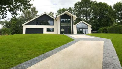 Resin Driveway with Pattern Imprinted Concrete Border to House on a Hill