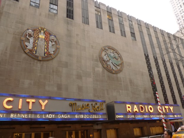 """The southern facade of the Music Hall, showing the Hildreth Meiere Medallions """"Drama"""" and """"Song""""."""