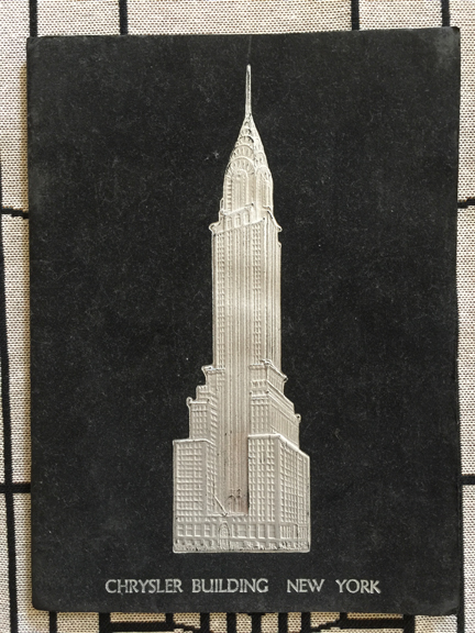 The embossed cover of the commemorative book.