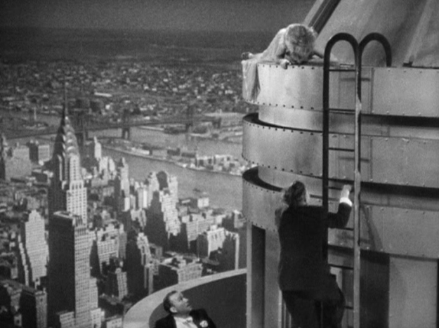 Fay Wray being rescued by Bruce Cabot while Robert Armstrong watches from the 103 floor terrace.
