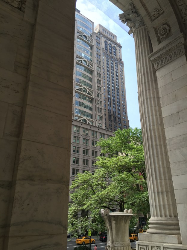 The former Chase Tower at 10 East 40th Street, through an arch of the New York Public Library.