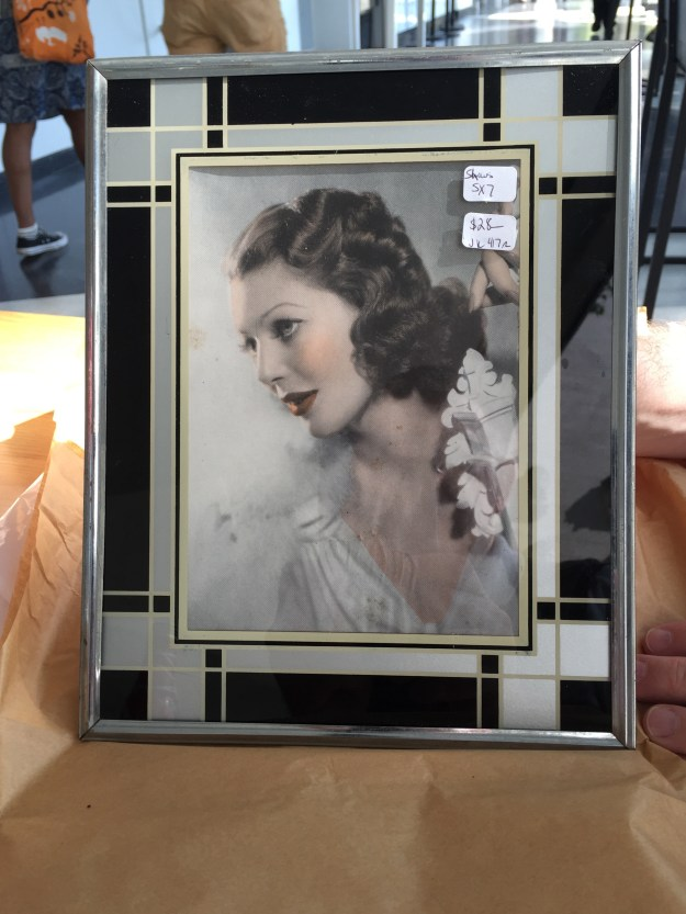 Loretta Young photo in a Deco reverse painted frame.