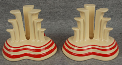 Red stripe tripod candle holders.