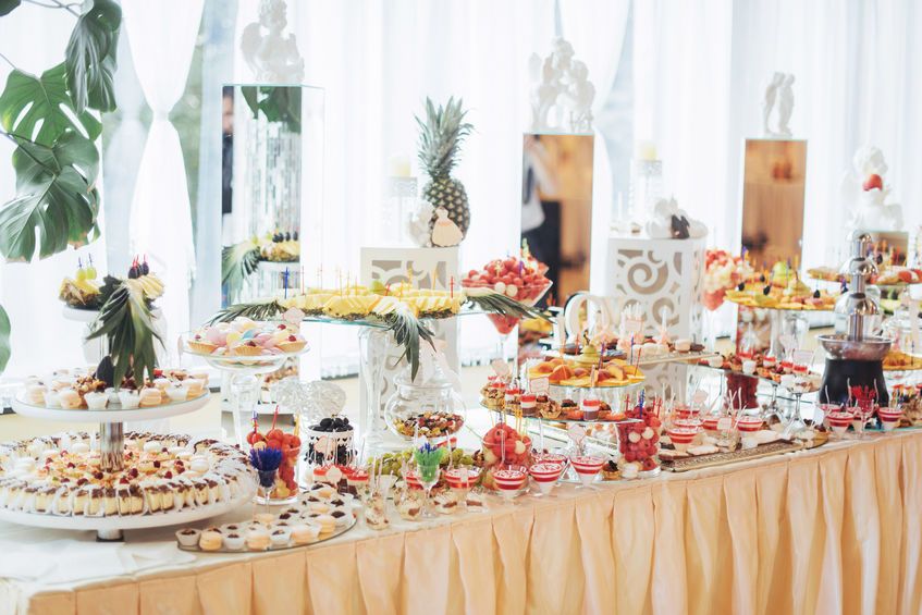 Banquet table full of fruits and berries an assortment