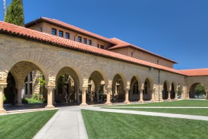 STANFORD, UNITED STATES - July 6: Memorial Court at historic Stanford University. The university features original sandstone walls with thick Romanesque features. July 6, 2013.