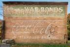 Coca Cola / War Bonds and Stamps / Barber Shop / Wardrobe Cleaners, Bald Knob, Arkansas
