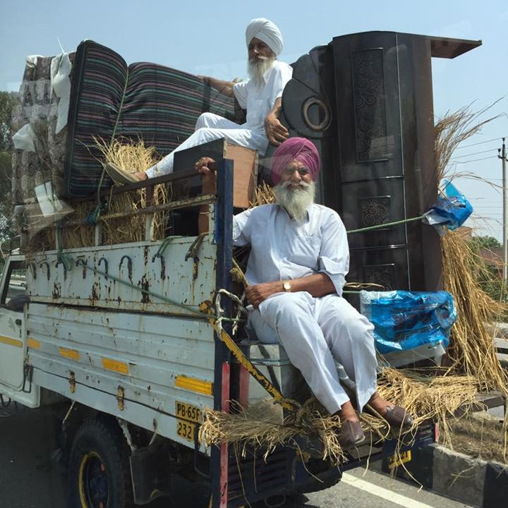"Photograph by Dr. Heather McIlvaine-Newsad ""Sikhs in Trucks"""