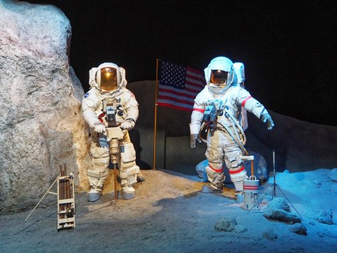 Mock up of astronauts on the moon.