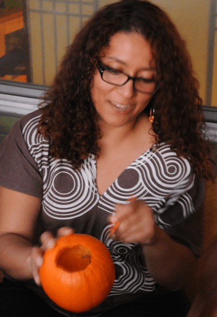 Jackie carving a pumpkin