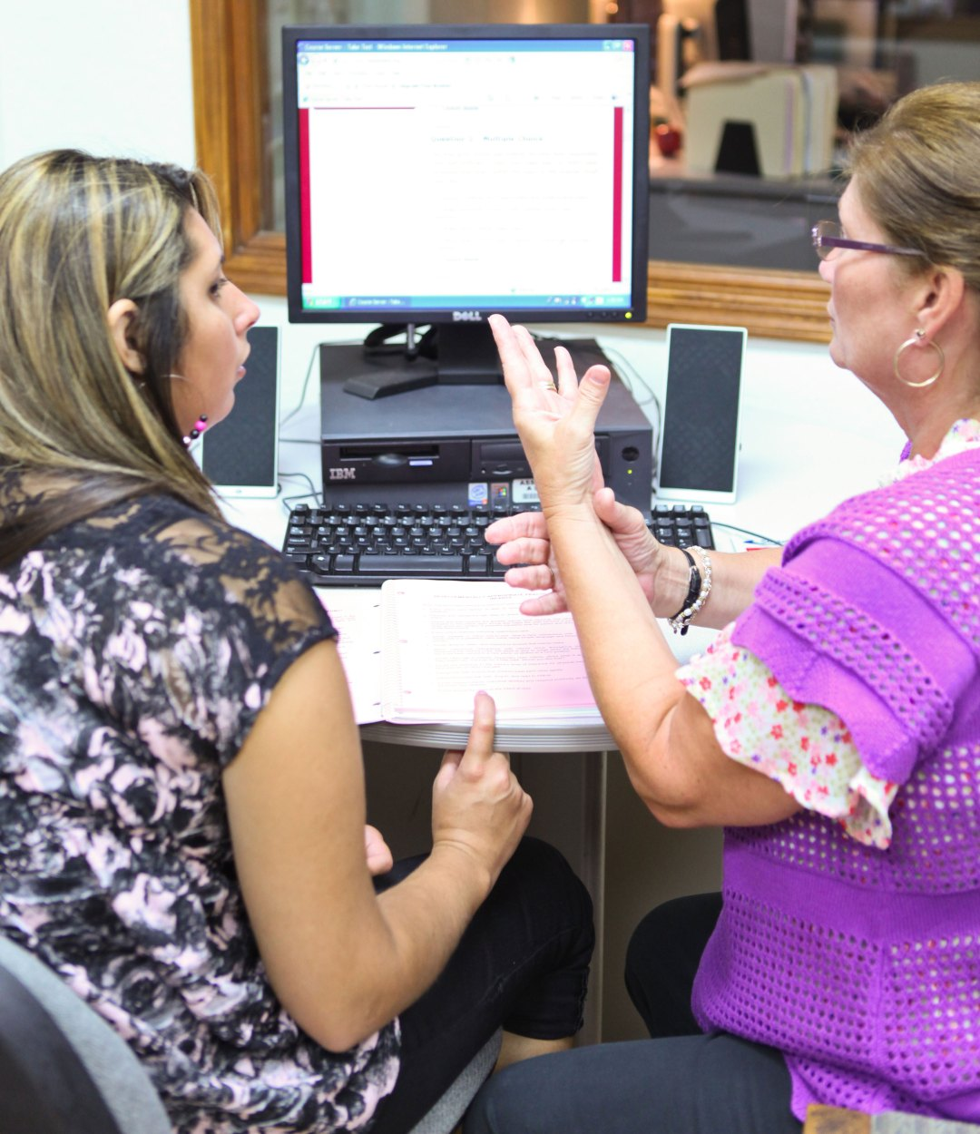 DRTC Employment Training Specialist Vivan (pictured, right) helps an individual through the job search process