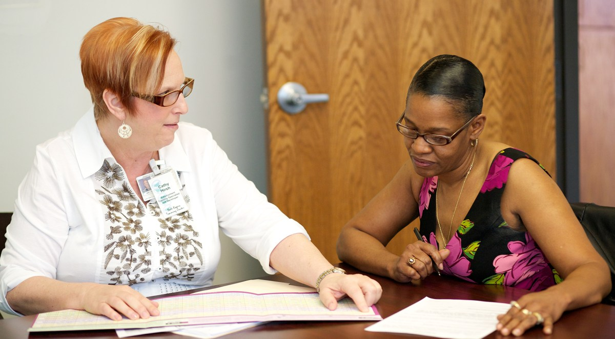 Employment Training Specialist Cathy (left) helps an individual find a job through DRTC's Employment Services Program
