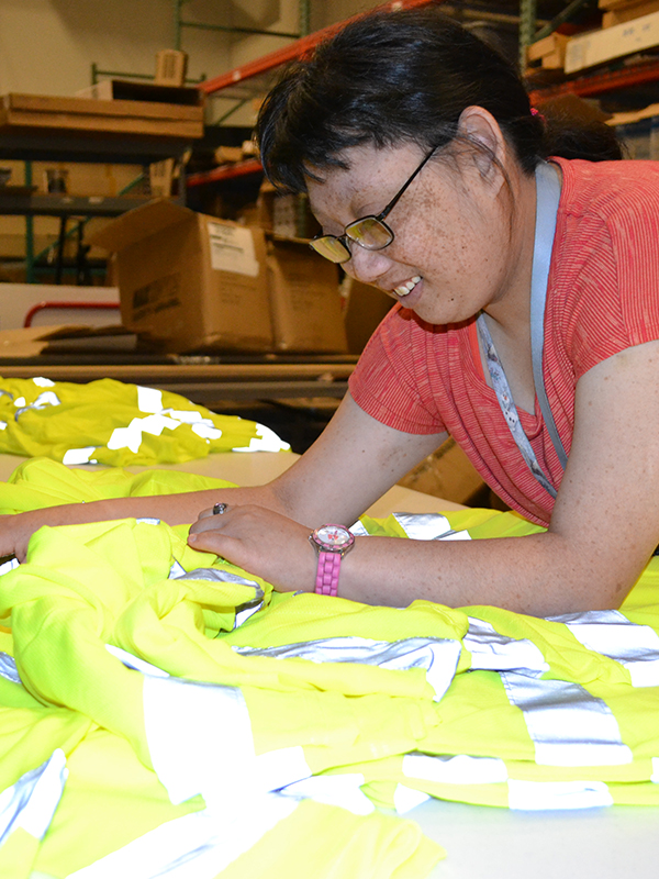 Lindsay counting reflective shirts for Prism Place.