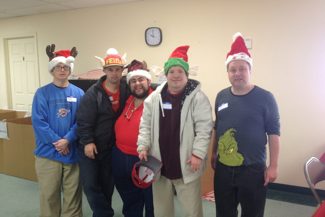 Five individuals with DRTC's Mobile Workforce program volunteering at Salvation Army.