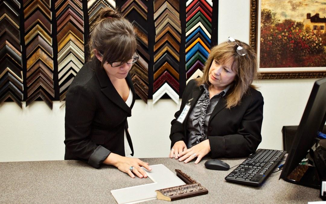 Carla assists a customer at Wyman Frame.