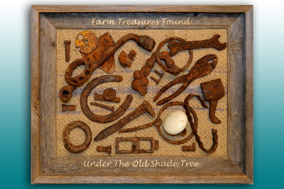 Several rusty items found at a farm, framed at DRTC Picture Frames.