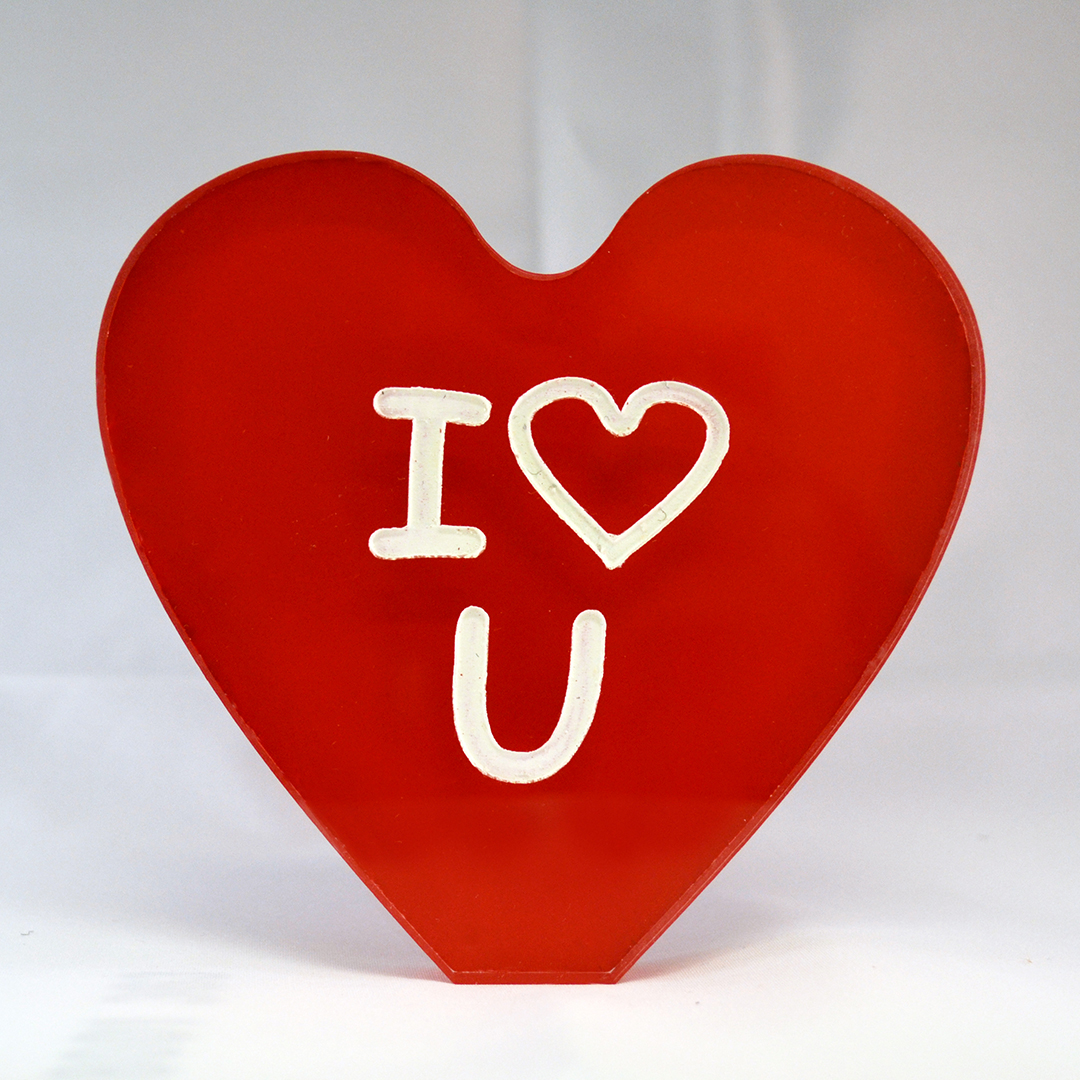 """Heart-shaped acrylic with """"I (heart) U"""" engraved."""