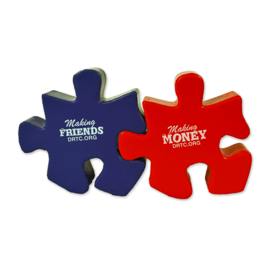 "Purple and red-colored puzzle piece stress relievers with text ""Making Friends, Making Money DRTC.org."""